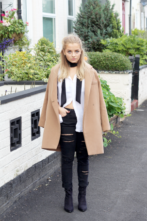 fashion blogger from little plum wearing a black skinny scarf