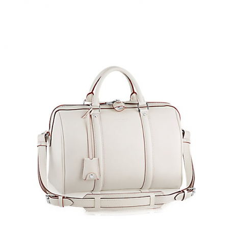 LOCKIT  Veau Cachemire leather makes this bag lightweight and practical for  everyday use. Still have any doubts about the perfectness of Louis Vuitton s  ... f9db47805e5