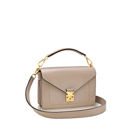 Biface  The Biface is two bags in one with adjustable and removable  shoulder strap and calf velour lining. 095f830996d