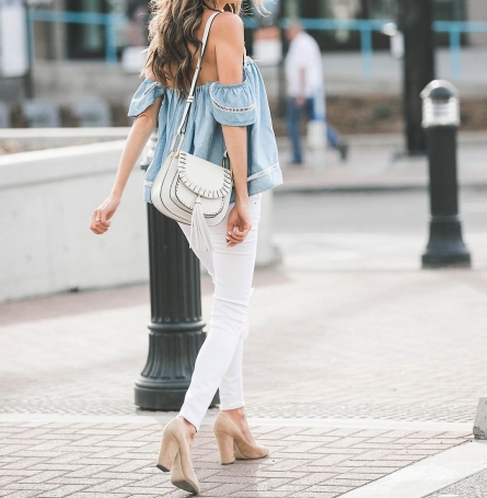 white jeans paired with a blue off shoulder top