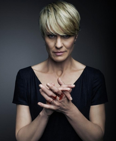Clair Underwood from the House of Cards. Hair stylists of the show styled her with a short cut to ac