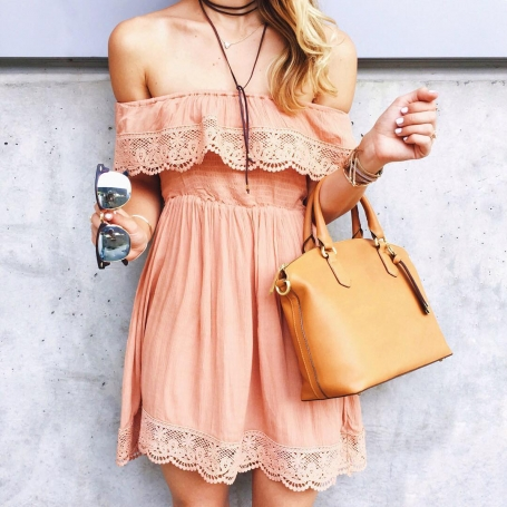 pastel color off shoulder dress with embroidery paired with a beige handbag and cool sunnies